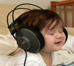 This baby is enjoying her listening task!